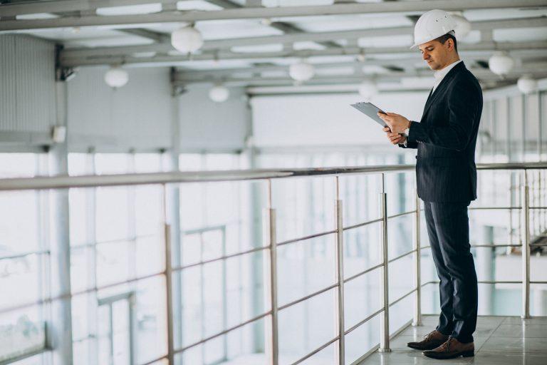 handsome-business-man-engineer-in-hard-hat-in-building
